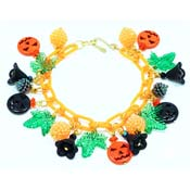 Halloween Celebration Charm Bracelet In Orange By Iris